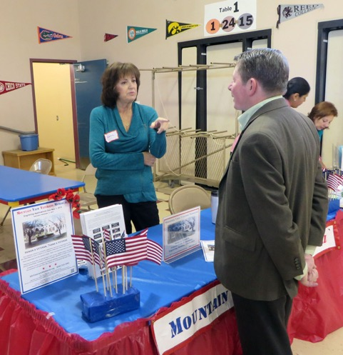 Karen Meredith explains the Veterans Memorail to John Inks