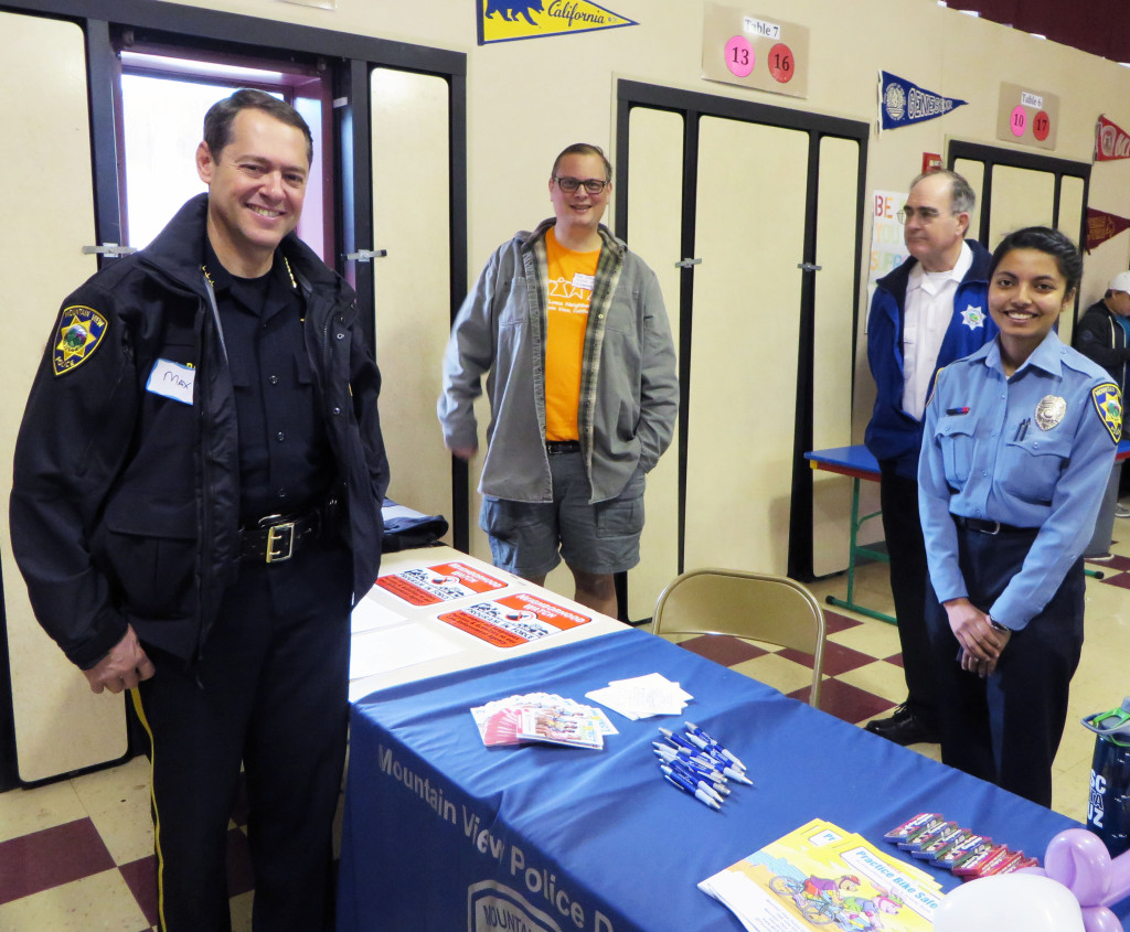 MVPD Chief Max Bosel, Neighborhood Watch Chair Tom Purcell, and two MVPD volunteers are ready for Spring Fling to begin.