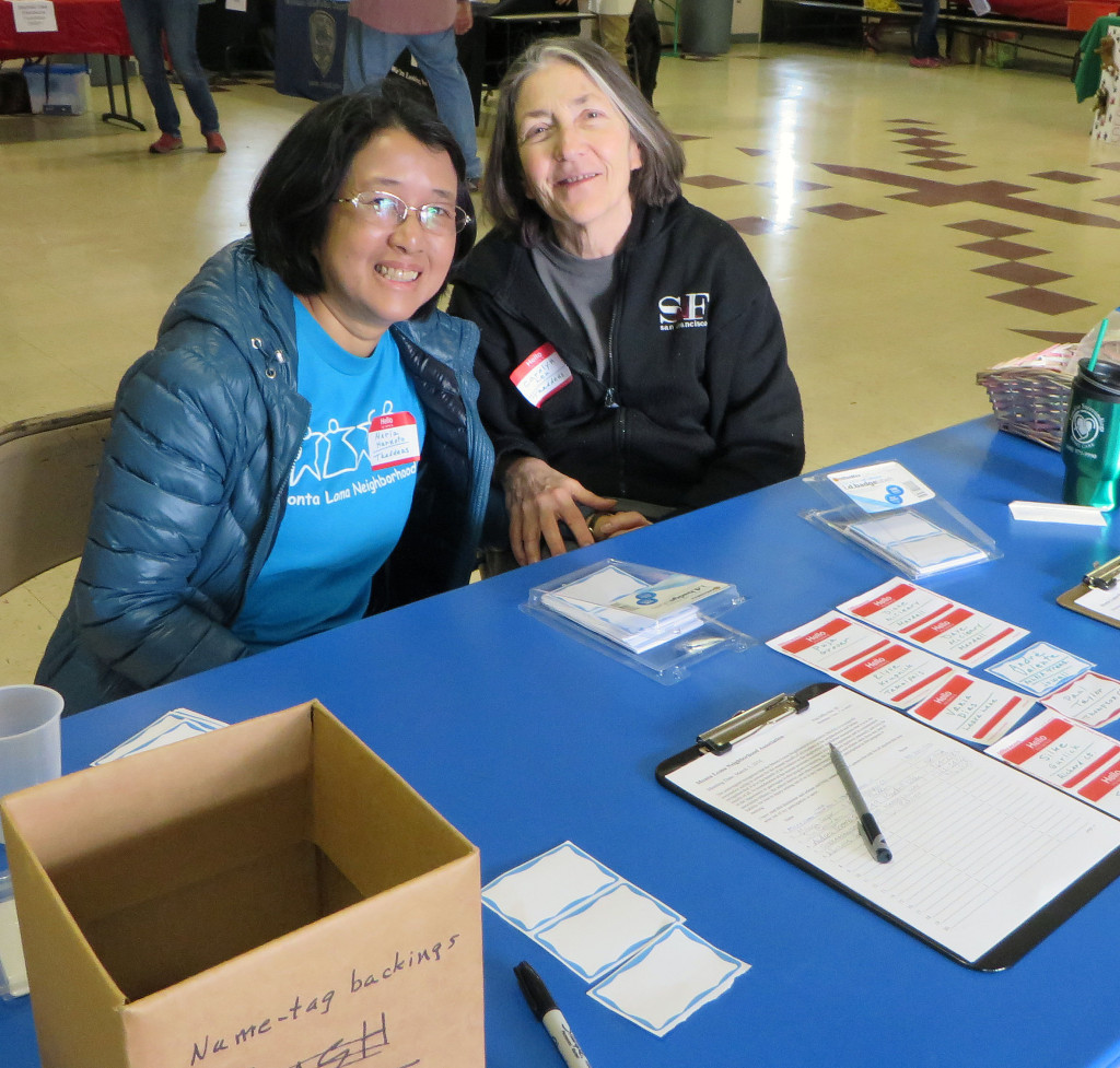 Maria Harnoto & Carolyn Len ready at the welcome table.