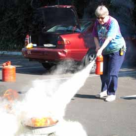 Mary Lou extinguishing a fire